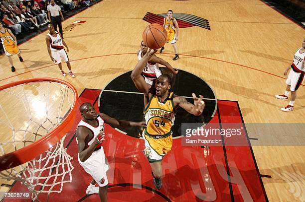 Chris Wilcox of the Seattle SuperSonics goes up for a shot past Zach Randolph of the Portland Trail Blazers during a game on March 18 2007 at the...