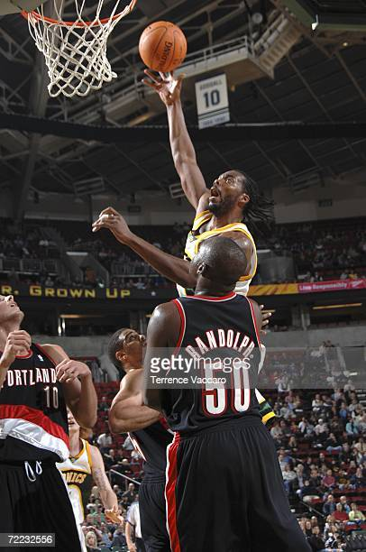 Chris Wilcox of the Seattle SuperSonics shoots against Zach Randolph of the Portland Trail Blazers on October 20 2006 at the Key Arena in Seattle...