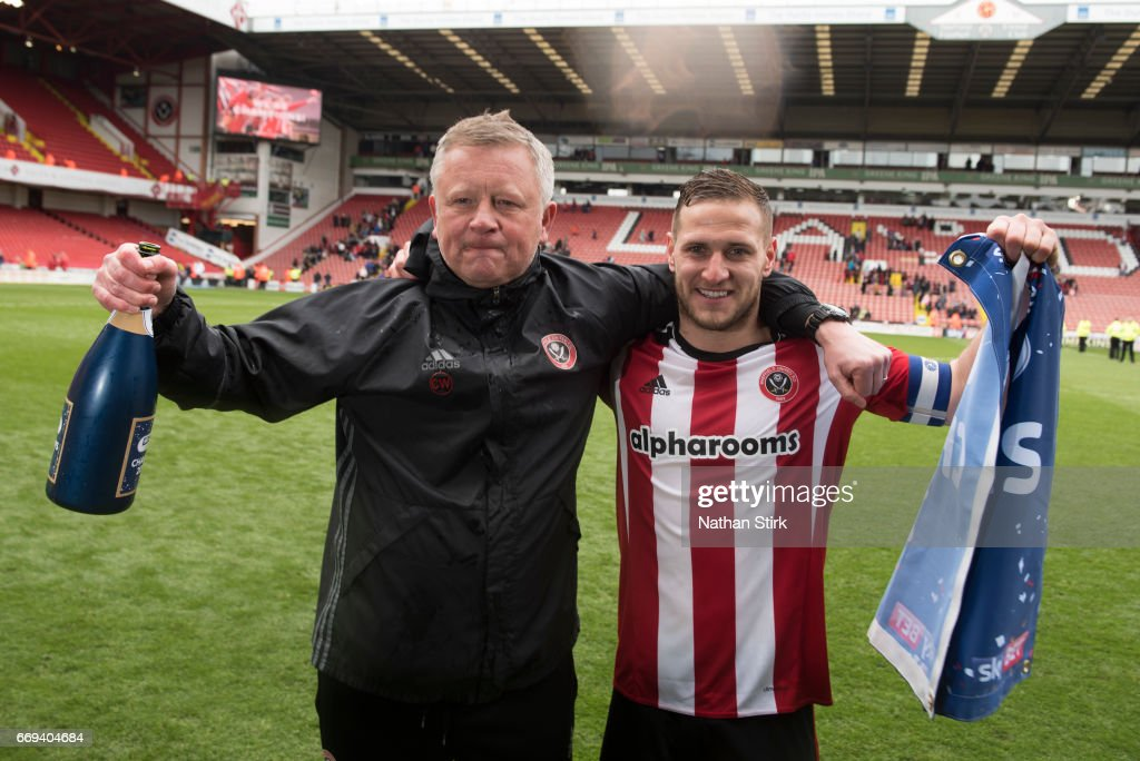 Chris Wilder manager of Sheffield United and Billy Sharp celebrate after winning promotion to the Sky Bet Championship after the Sky Bet League One match between Sheffield United and Bradford City at Bramall Lane on April 17, 2017 in Sheffield, England.