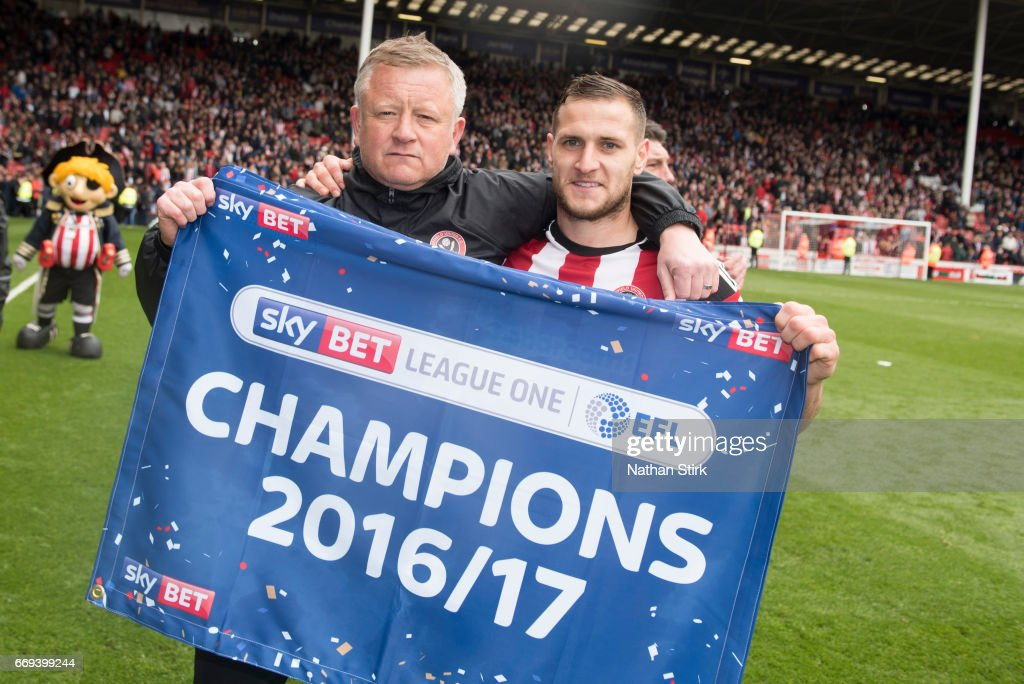 Chris Wilder manager of Sheffield United and Billy Sharp celebrates after winning promotion to the Sky Bet Championship after the Sky Bet League One match between Sheffield United and Bradford City at Bramall Lane on April 17, 2017 in Sheffield, England.