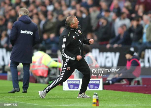 Chris Wilder, Manager of Sheffield United celebrates after his sides first goal during the Premier League match between West Ham United and Sheffield...