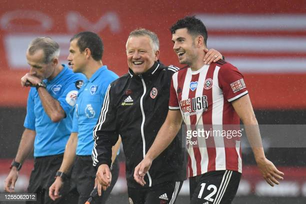 Chris Wilder, Manager of Sheffield United celebrates with John Egan of Sheffield United after the Premier League match between Sheffield United and...