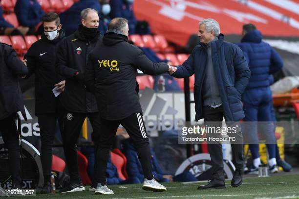 Chris Wilder, Manager of Sheffield United interacts with Jose Mourinho, Manager of Tottenham Hotspur during the Premier League match between...