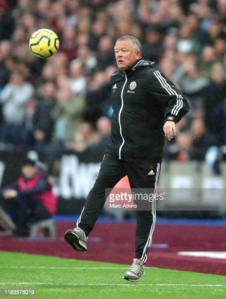 Chris Wilder, Manager of Sheffield United kicks the ball during the Premier League match between West Ham United and Sheffield United at London...