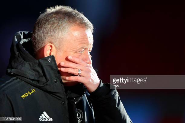 Chris WIlder, Manager of Sheffield United reacts as he watches his side warm up prior to kick off during the Premier League match between Sheffield...