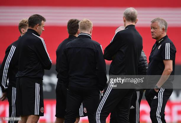 Chris Wilder Manager of Sheffield United speaks to his coaching staff at fulltime after the Premier League match between Southampton FC and Sheffield...