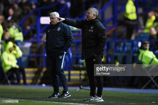 Chris Wilder manager of Sheffield United stands alongside Steve Bruce manager of Sheffield Wednesday during the Sky Bet Championship match between...