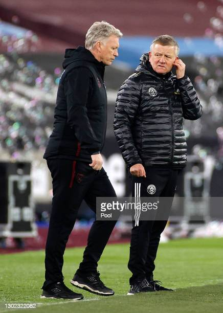 Chris Wilder, Manager of Sheffield United talks to David Moyes, Manager of West Ham following the Premier League match between West Ham United and...