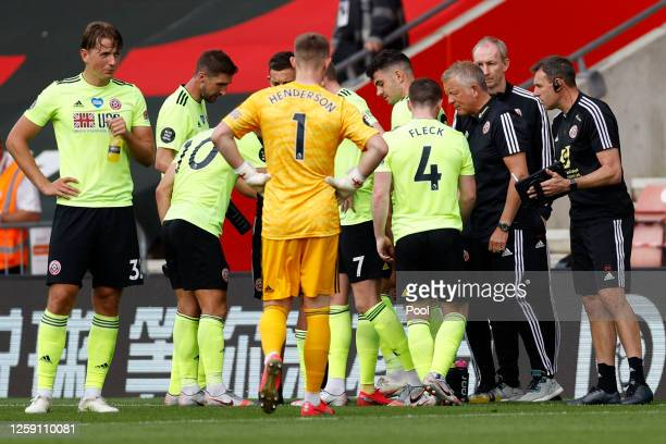 Chris Wilder Manager of Sheffield United talks with his players during drinks break during the Premier League match between Southampton FC and...