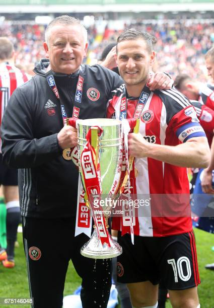 Chris Wilder, Sheffield United manager and Billy Sharp, Captain of Sheffield United celebrate as they win promotion into next seasons Sky Bet...