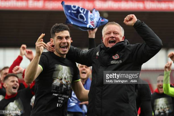 Chris Wilder the head / coach of Sheffield United and John Egan of Sheffield United celebrate promotion to the Premier League during the Sky Bet...