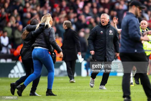 Chris Wilder the head / coach of Sheffield United instructs fans to get off the pitch at full time during the Sky Bet Championship match between...