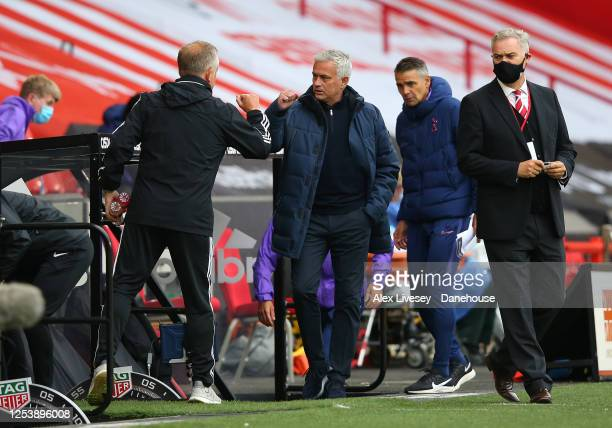 Chris Wilder the manager of Sheffield United and Jose Mourinho the manager of Tottenham Hotspur greet each other prior to the Premier League match...