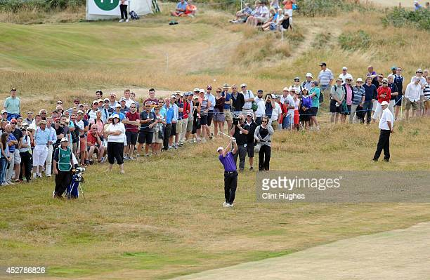 Chris Williams of England plays an approach shot on the 6th hole during the fourth round of the Senior Open Championship at Royal Porthcawl Golf Club...