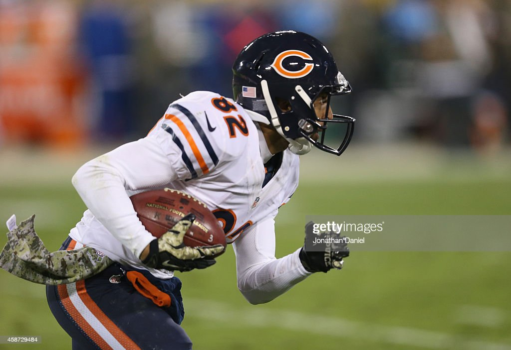 Chris Williams #82 of the Chicago Bears returns a kick against the Green Bay Packers at Lambeau Field on November 9, 2014 in Green Bay, Wisconsin. Green Bay Packers defeat the Chicago Bears 55 to 14.