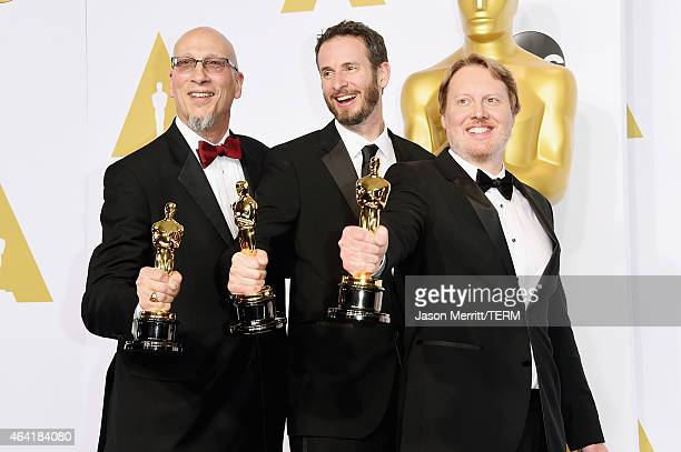 Chris Williams, Roy Conli, and Don Hall, winners of the Best Animated Feature Award for 'Big Hero 6', pose in the press room during the 87th Annual...
