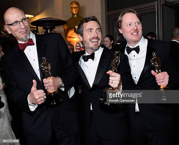 Chris Williams Roy Conli and Don Hall winners of the Best Animated Feature Award for 'Big Hero 6 attends the 87th Annual Academy Awards Governors...