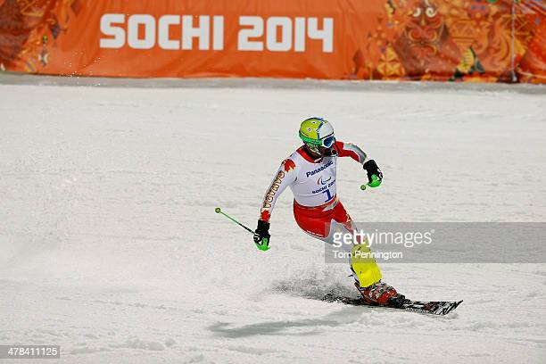 Chris Williamson of Canada at the finish in the Men's Slalom 2nd Run Visually Impaired during day six of Sochi 2014 Paralympic Winter Games at Rosa...