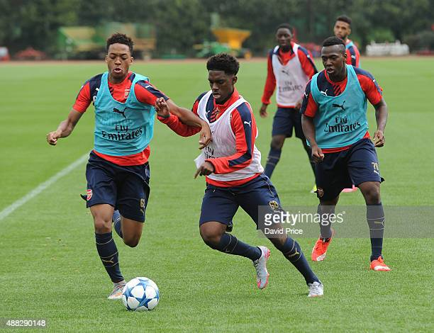 Chris Willock Aaron Eyoma and Tolaji Bola of Arsenal during the U19 training session at London Colney on September 15 2015 in St Albans England