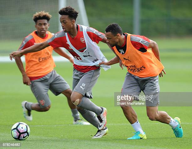 Chris Willock and Francis Coquelin of Arsenal during a training session at London Colney on July 21, 2016 in St Albans, England.
