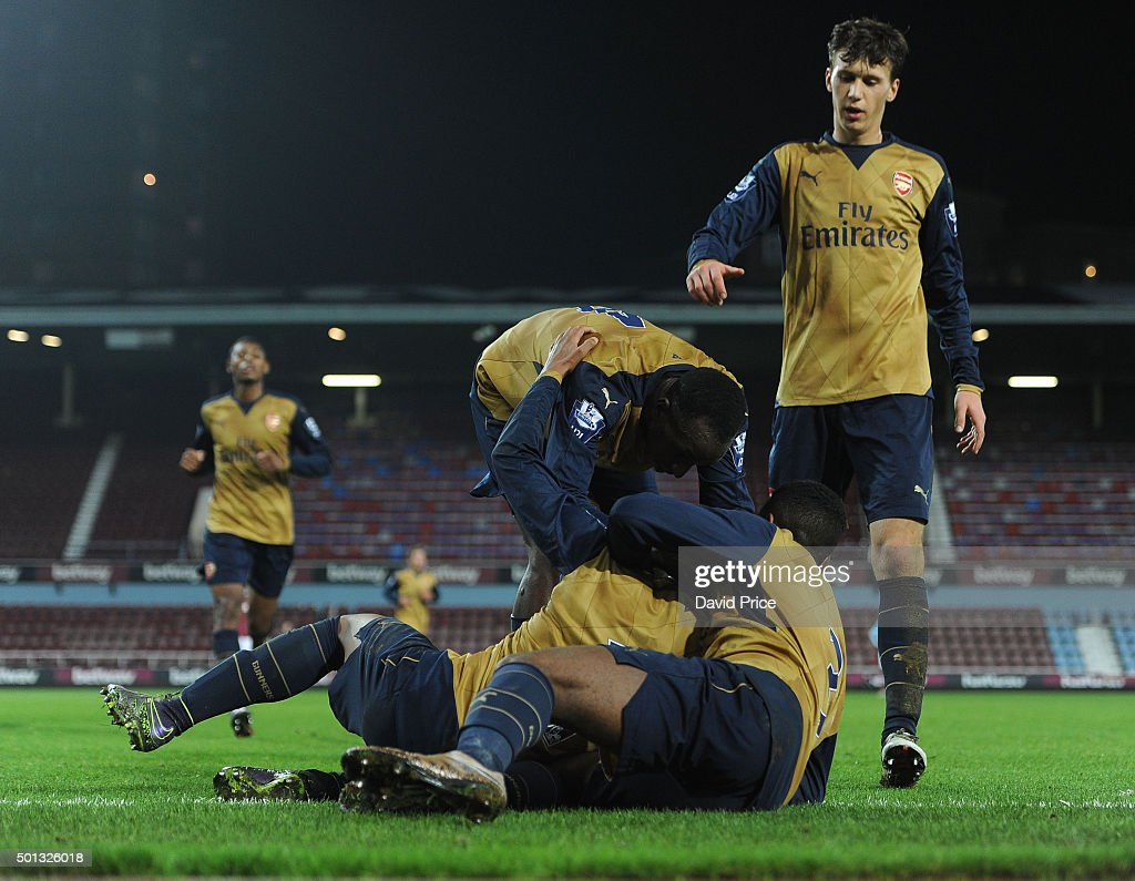 Chris Willock celebrates scoring Arsenal's goal with Tyrell Robinson, Glen Kamara and Krystian Bielik during match between West Ham United U21 and Arsenal U21 at Boleyn Ground on December 14, 2015 in London, England.