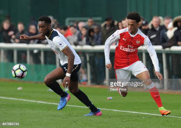 Chris Willock of Arsenal takes on Christian Maghoma of Tottenham during the match between Arsenal U23 and Tottenham Hotspur U23 at London Colney on...
