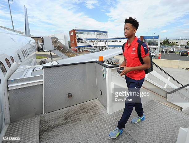 Chris Willock of Arsenal U19 team boards the plane at Luton Airport on September 12 2016 in Luton England