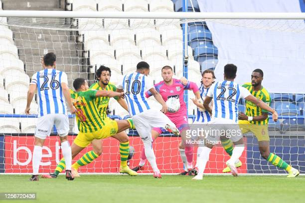 Chris Willock of Huddersfield Town scores his team's first goal during the Sky Bet Championship match between Huddersfield Town and West Bromwich...