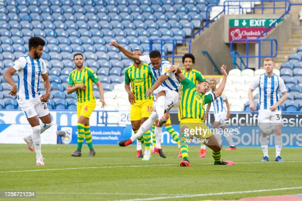 Chris Willock of Huddersfield Town scores to make it 1-0 during the Sky Bet Championship match between Huddersfield Town and West Bromwich Albion at...