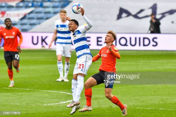 Chris Willock of QPR contests a header with Kiernan Dewsbury-Hall of Luton town during the Sky Bet Championship match between Queens Park Rangers and...