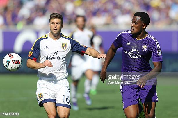 Chris Wingert of Real Salt Lake and Cyle Larin of Orlando City SC chase a loose ball during a MLS soccer match at the Orlando Citrus Bowl on March 6...
