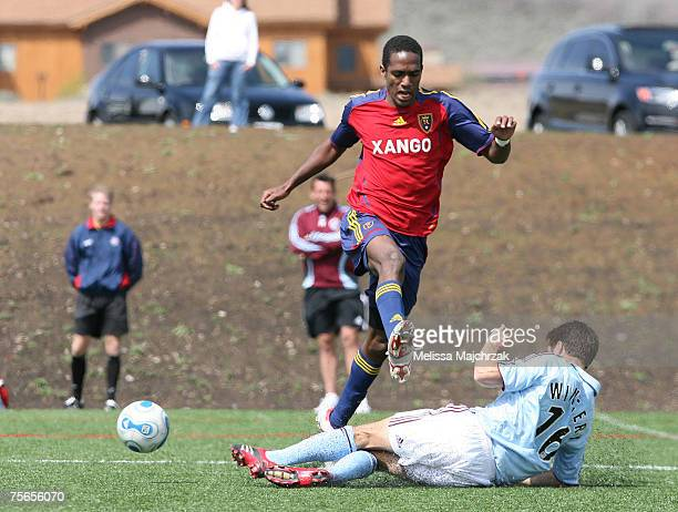Chris Wingert of the Colorado Rapids kicks the ball out from Atiba Harris of the Real Salt Lake on May 01 2007 in Salt Lake City UT