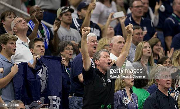 Chris Wirthwein of Carmel Indiana celebrates Butler's 7161 victory over Texas Tech in the first round of the NCAA Tournament at PNC Arena on March 17...
