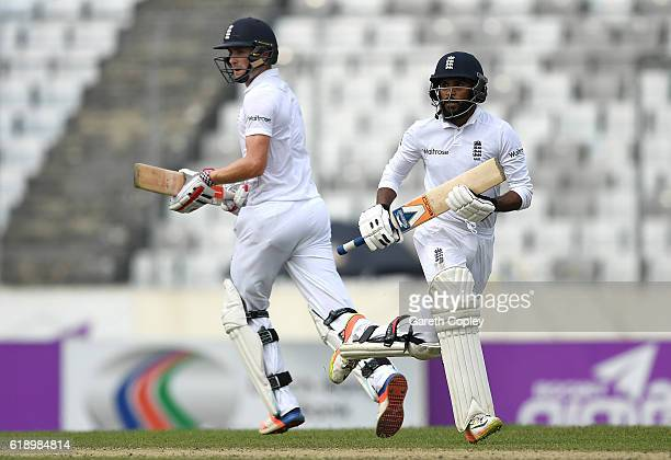 Chris Woakes and Adil Rashid of England run between the wickets during the second day of the 2nd Test match between Bangladesh and England at...