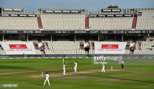 Chris Woakes and Dom Bess of England celebrate victory on Day Four of the 1st #RaiseTheBat Test Match between England and Pakistan at Emirates Old...