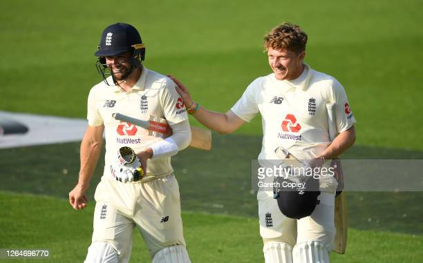 Chris Woakes and Dom Bess of England walk off after victory on Day Four of the 1st #RaiseTheBat Test Match between England and Pakistan at Emirates...
