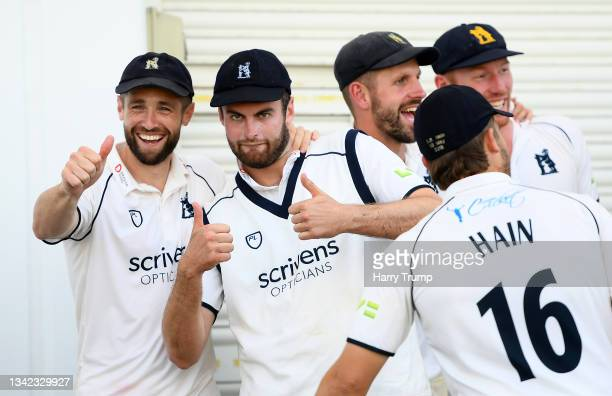 Chris Woakes and Dominic Sibley of Warwickshire celebrate following Day Four of the LV= Insurance County Championship match between Warwickshire and...