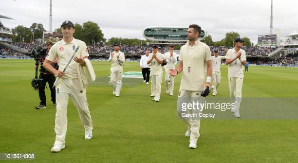 Chris Woakes and James Anderson of England lead their team from the field after winning the 2nd Specsavers Test between England and India at Lord's...