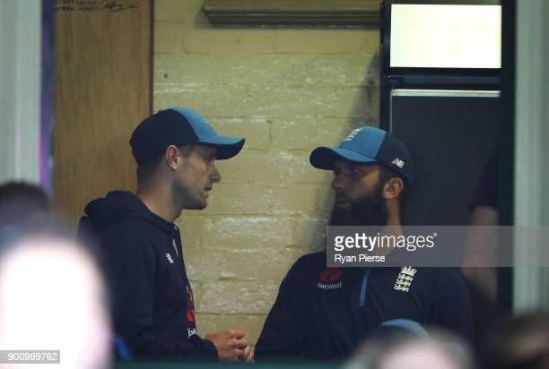 Chris Woakes and Moeen Ali of England look on as rain delays the start of play during day one of the Fifth Test match in the 2017/18 Ashes Series...