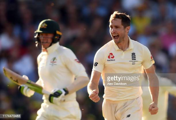 Chris Woakes celebrates the wicket of Steve Smith of Australia during Day Two of the 5th Specsavers Ashes Test between England and Australia at The...
