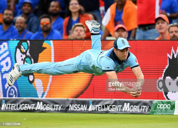 Chris Woakes dives to take a catch to dismiss Rishabh Pant of India during the Group Stage match of the ICC Cricket World Cup 2019 between England...