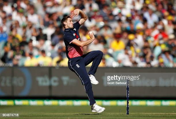 Chris Woakes of England bowls during game one of the One Day International Series between Australia and England at Melbourne Cricket Ground on...