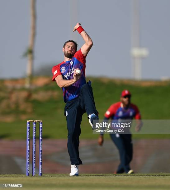 Chris Woakes of England bowls during the England and New Zealand warm Up Match prior to the ICC Men's T20 World Cup at on October 20, 2021 in Abu...