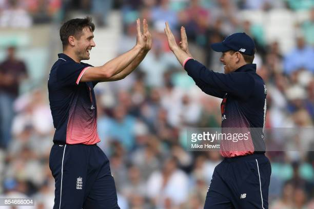 Chris Woakes of England celebates with Eoin Morgan after dismissing Marlon Samuels of West Indies during the 4th Royal London One Day International...