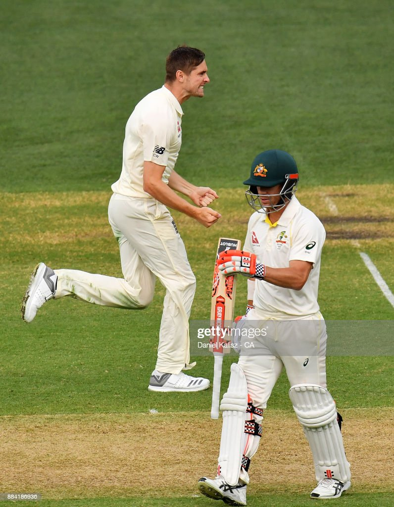 Chris Woakes of England celebrates after dismissing David Warner of Australia during day one of the Second Test match during the 2017/18 Ashes Series between Australia and England at Adelaide Oval on December 2, 2017 in Adelaide, Australia.