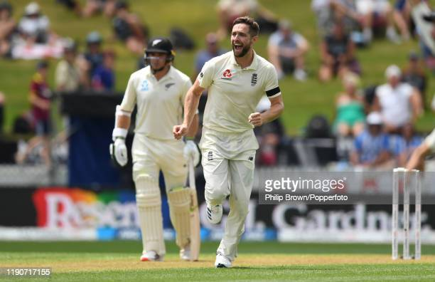 Chris Woakes of England celebrates after dismissing Kane Williamson during day 1 of the second Test match between New Zealand and England at Seddon...