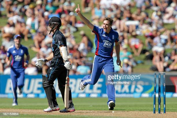 Chris Woakes of England celebrates after dismissing Kane Williamson of New Zealand during the second match of the international Twenty20 series...