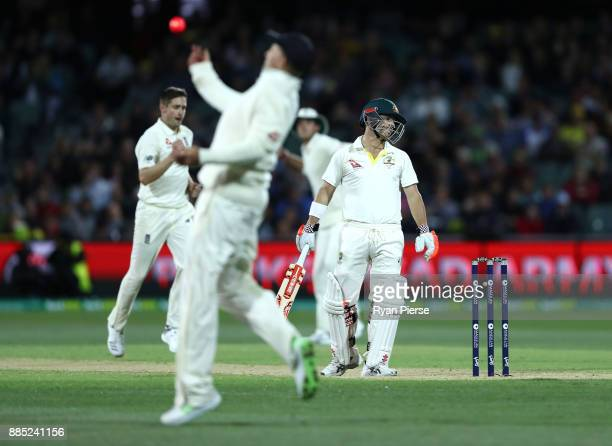 Chris Woakes of England celebrates after Joe Root of England caught David Warner of Australia during day three of the Second Test match during the...
