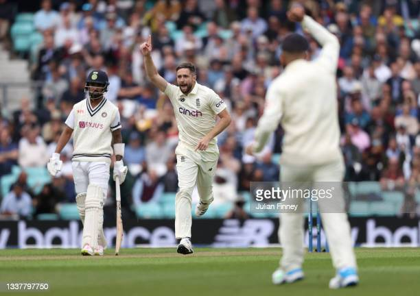 Chris Woakes of England celebrates after Jonny Bairstow of England catches out Rohit Sharma of India during day one at The Kia Oval on September 02,...