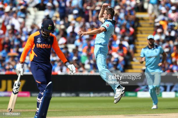 Chris Woakes of England celebrates after taking a catch off his own bowling to dismiss KL Rahul of India during the Group Stage match of the ICC...